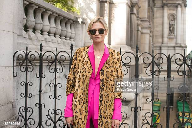 Fashion blogger Pandora Sykes wears Shrimps coat Pallas jacket and trousers Balenciaga shoes and Ray Ban sunglasses on day 2 of Paris Collections...