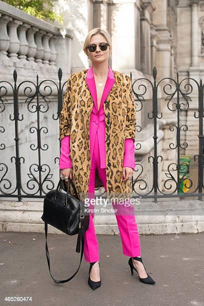 Fashion blogger Pandora Sykes wears Shrimps coat Pallas jacket and trousers Balenciaga shoes Saint Laurent bag and Ray Ban sunglasses on day 2 of...
