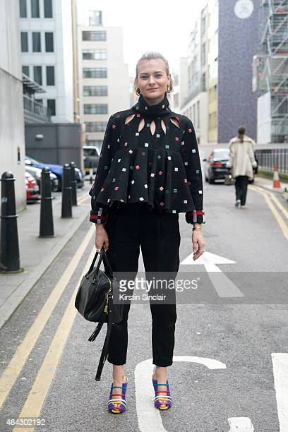 Fashion blogger Pandora Sykes wears Yves Saint Laurent bag All saints trousers and N Duo Concept top and Malone Souliers shoes on February 23 2015 in...