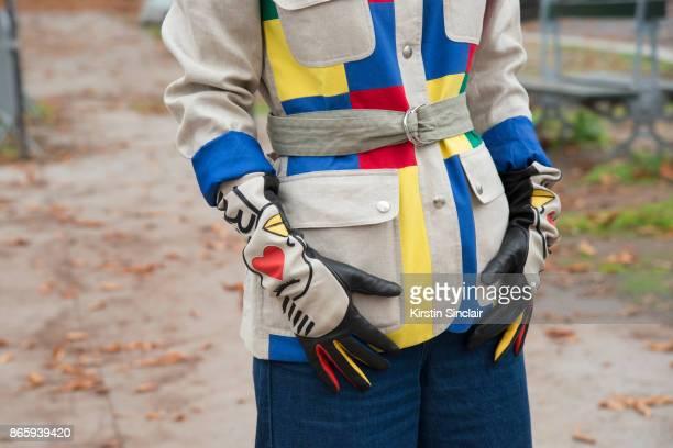 Fashion blogger Pauline de Drouas wears a Vintage Castelbajac jacket Maje jeans and Agnelle x Castelbajac gloves day 2 of Paris Womens Fashion Week...
