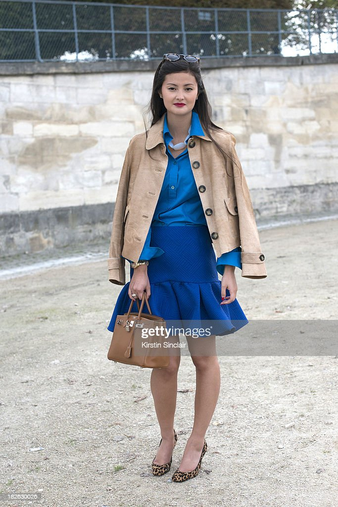 Fashion blogger Peony Lim wears a Burberry jacket, Asos skirt, Hermes top and bag and Christian Louboutin shoes on day 7 of Paris Fashion Week Spring/Summer 2014, Paris September 30, 2013 in Paris, France.