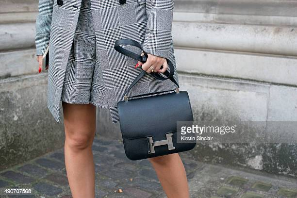 Fashion Blogger Peony Lim wears a Reiss jacket top and shorts and a Hermes bag on day 3 during London Fashion Week Spring/Summer 2016/17 on September...