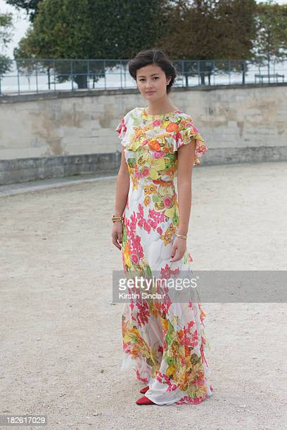 Fashion blogger Peony Lim wears an Isolda dress with Manolo Blahnik shoes on day 8 of Paris Fashion Week Spring/Summer 2014, Paris October 01, 2013...