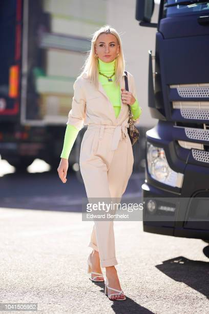 Fashion blogger Queen of Jet Lags wears a green turtleneck a white jumpsuit outside Margiela during Paris Fashion Week Womenswear Spring/Summer 2019...