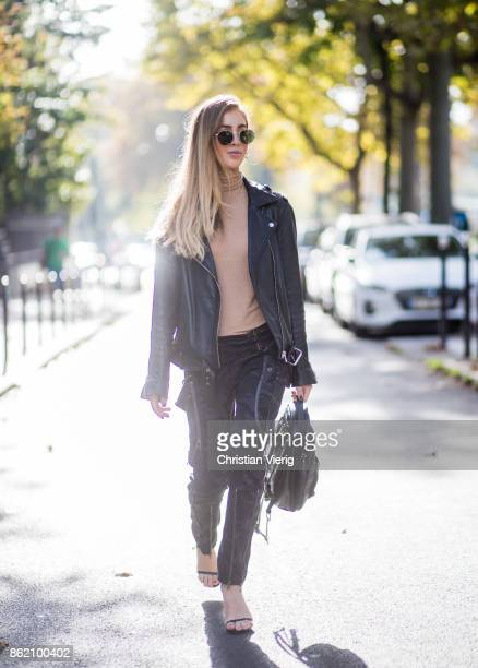 Fashion Blogger Rosa Crespo wearing Faith Connexion pants heels Saint Laurent black All Saints leather jacket beige turtleneck black Nat Nin backpack...