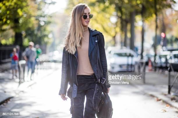 Fashion Blogger Rosa Crespo wearing Faith Connexion pants heels Saint Laurent black All Saints leather jacket beige turtleneck black Nat Nin backpack...