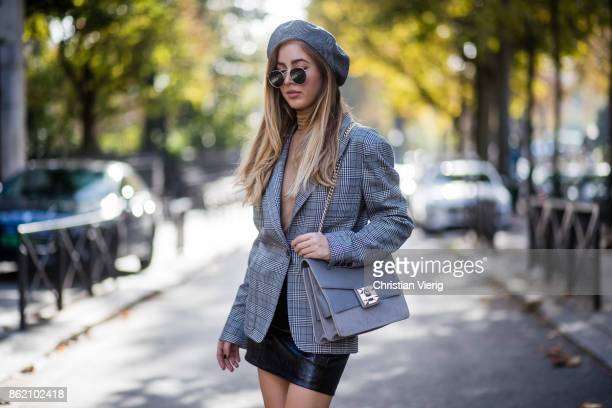 Fashion Blogger Rosa Crespo wearing grey checked blazer Faith Connexion black leather skirt Sunset Spring Marc Fischer boots grey Salar Milano bag...