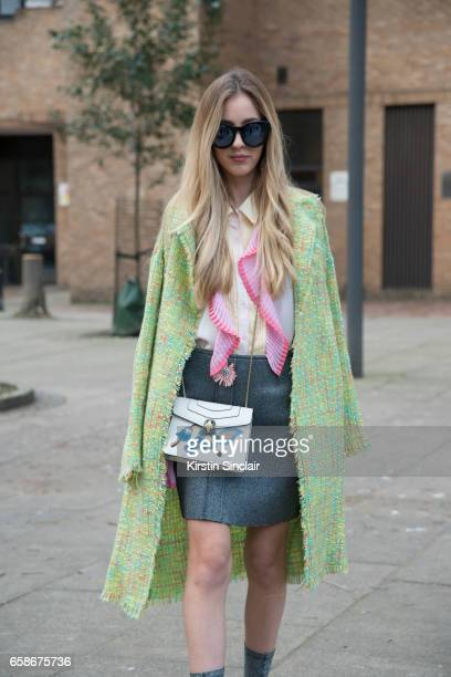 Fashion blogger Rosa Crespo wears a Storets shirt and jacket Bvlgari bag Top Shop shoes and skirt and Quay sunglasses on day 3 of London Womens...