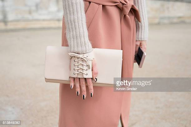 Fashion Blogger Samantha Angelo wears a Malena Birger coat Perrin Paris bag and an Acne sweater on day 4 during Paris Fashion Week Autumn/Winter...