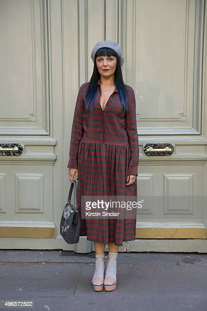 Fashion Blogger Sandra Bacchi wears a Lola dress Red Valentino bag and shoes and a vintage hat on day 5 during Paris Fashion Week Spring/Summer...