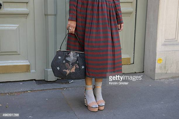 Fashion Blogger Sandra Bacchi wears a Lola dress Red Valentino bag and shoes on day 5 during Paris Fashion Week Spring/Summer 2016/17 on October 3...