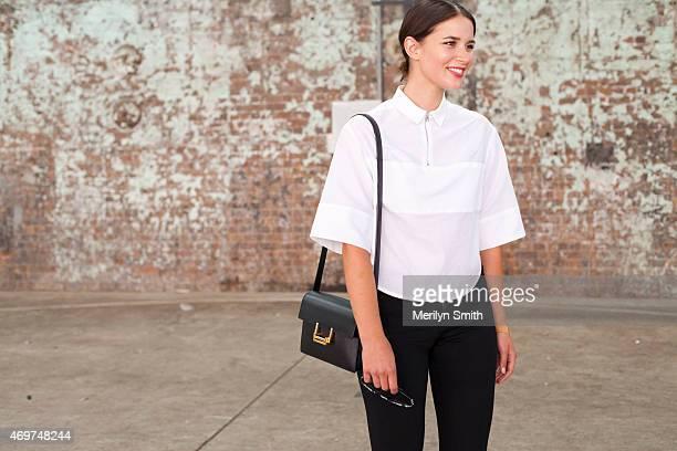 Fashion Blogger Sara Donaldson wears Frame jeans Josh Goot top and Saint Laurent bag at MercedesBenz Fashion Week Australia 2015 at Carriageworks on...