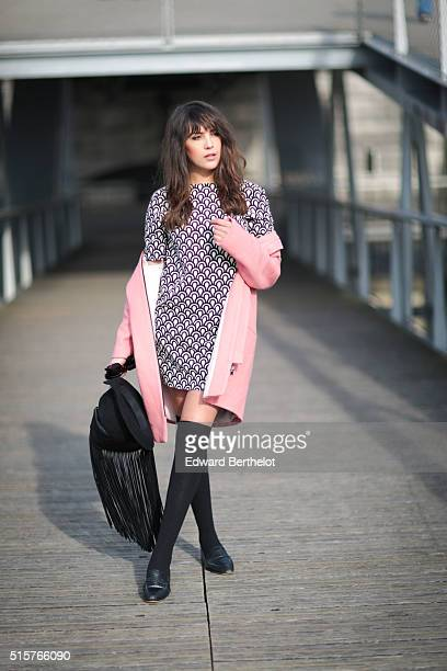 Fashion blogger Sarah Benziane is wearing a Zara pink coat a Zara dress and a Zara bag during a street style session on March 15 2016 in Paris France