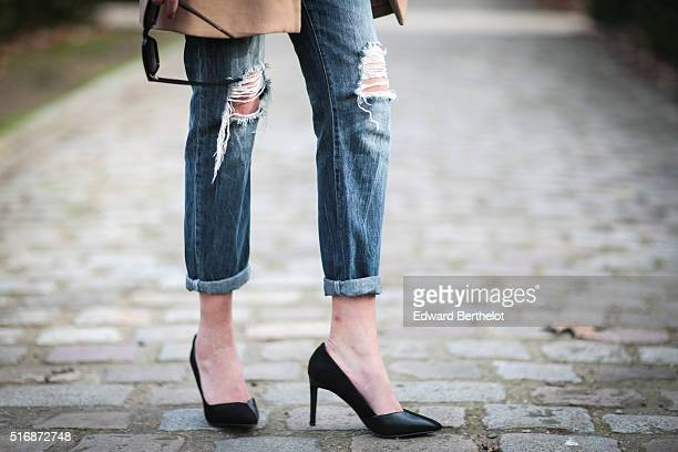 Fashion blogger Sarah Benziane is wearing an HM top an HM coat Primark jeans Charles and Keith shoes and Saint Laurent sunglasses during a street...