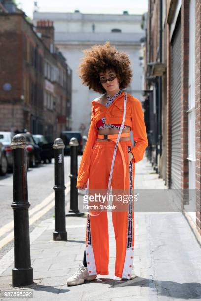 Fashion blogger Sarah Guessab wears a Tommy Hilfiger bra Champion trousers Urban Outfitters sunglasses House of London jacket and Yeezy trainers...