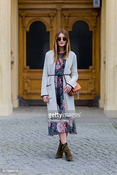 Fashion blogger Sofia Grau is wearing a green pink dress with floral print and grey long cardigan from Zara bag Chloe Faye belt vintage sunglasses...