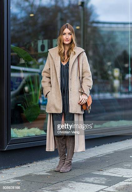 Fashion blogger Sofia Grau of She Comes In Colors wearing Zara dress Stuart Weitzman boots HN cardigan Chloe faye bag joop coat during the...