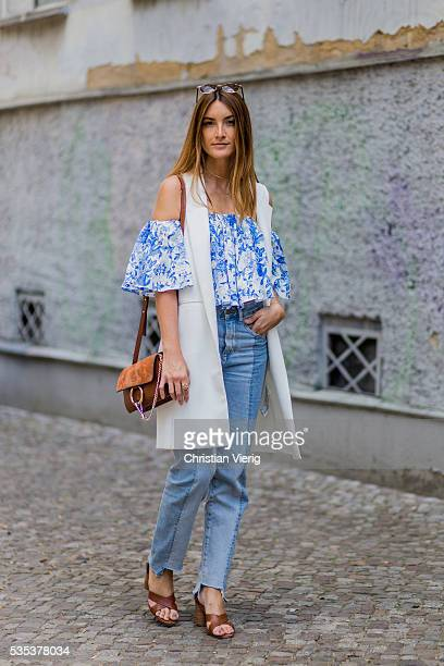 Fashion blogger Sofia Grau wearing a blue two tone hm trend denim jeans a blue white off shoulder Zara top and white vest brown otherstories sandals...