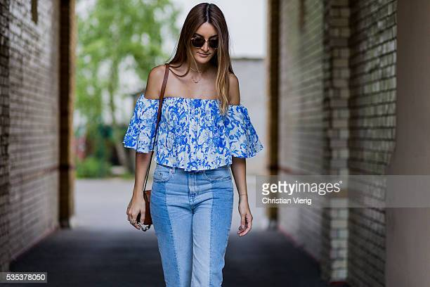Fashion blogger Sofia Grau wearing a blue two tone hm trend denim jeans a blue white off shoulder Zara top a brown Chloe faye bag and Rayban...