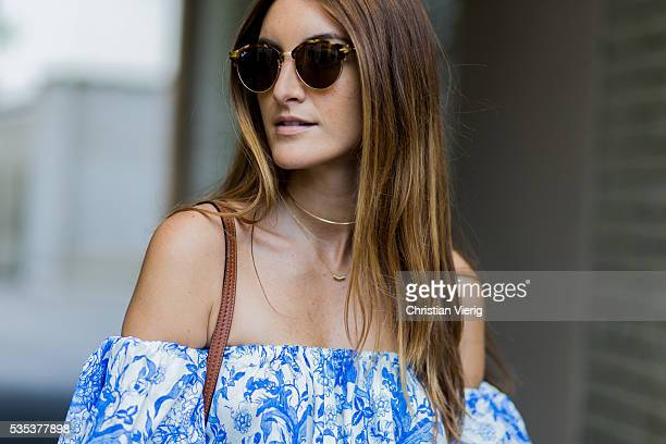 Fashion blogger Sofia Grau wearing a blue white off shoulder Zara top and Rayban sunglasses on May 29 2016 in Berlin Germany