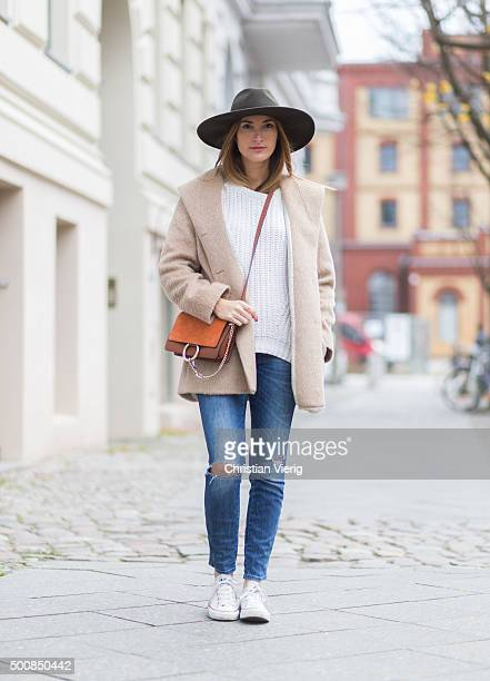 Fashion Blogger Sofia Grau wearing Chloe bag Converse shoes Goorin Bros hat Mango sweater Max and Co coat on December 10 2015 in Berlin Germany