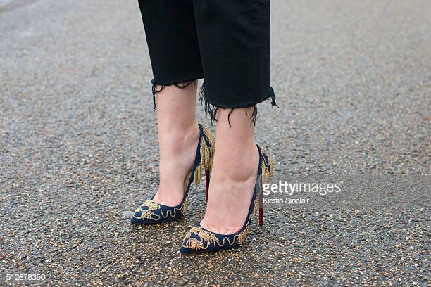 Fashion blogger Sofie Valkiers wears a Burberry trousers and Christian Louboutin shoes on day 4 during London Fashion Week Autumn/Winter 2016/17 on...