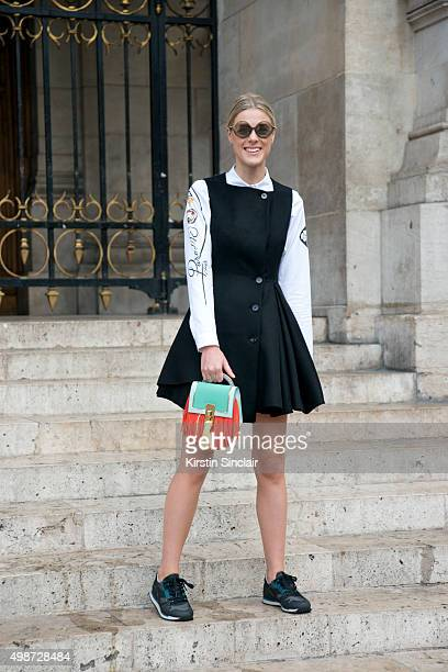 Fashion Blogger Sofie Valkiers wears a Dior dress shirt and sunglasses Louis Vuitton bag and Viador trainers on day 7 during Paris Fashion Week...