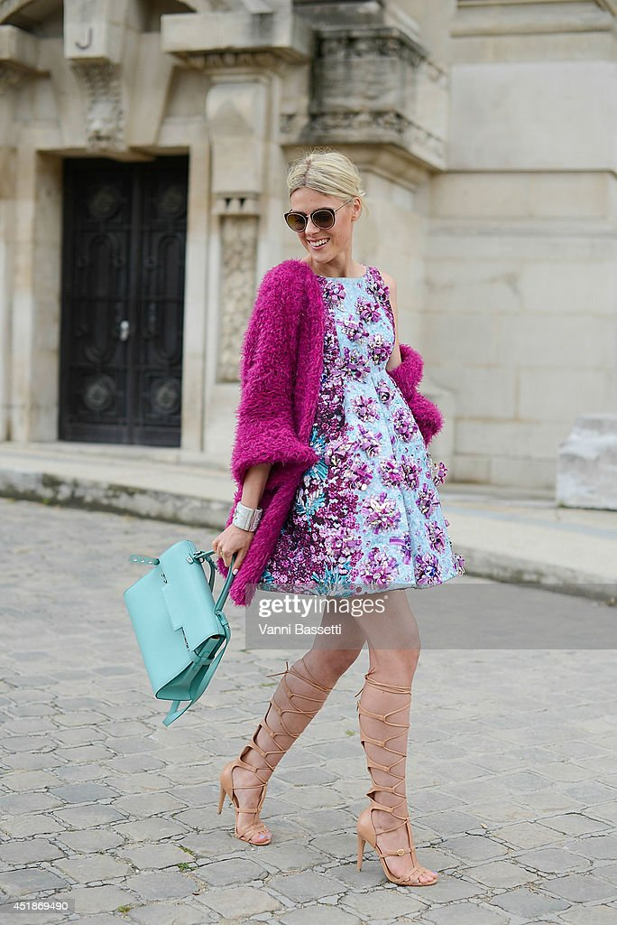 Fashion blogger Sofie Valkiers wears a Mary Katranzou dress, a Delvaux bag and Schutz shoes before Chanel show on July 8, 2014 in Paris, France.
