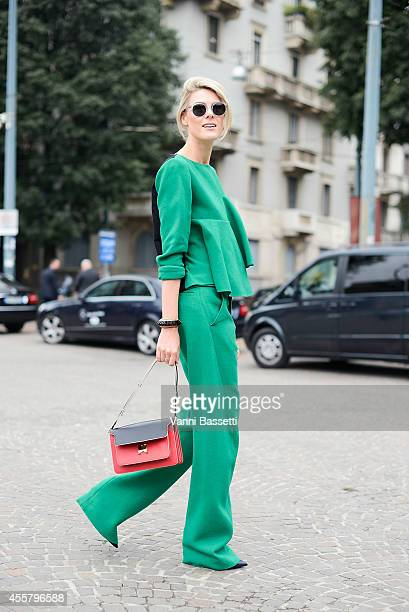 Fashion blogger Sofie Valkiers wears Marni total look Louis Vuitton jewels and Hyde's sunglasses on September 20 2014 in Milan Italy