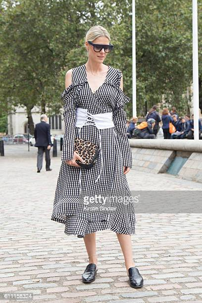 Fashion blogger Sofie Valkiers wears Preen dress Robert Clergerie shoes Leo Wolf sunglasses and Celine bag on day 3 of London Womens Fashion Week...