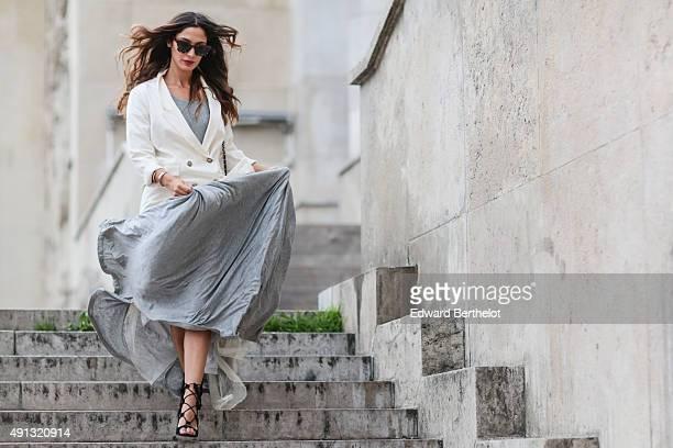 Fashion blogger Sofya Benzakour wearing a Chemya dress a Chanel bag a Kookai jacket and Edwardson sunglasses after the John Galliano show during...