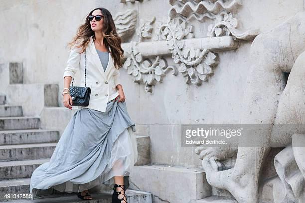 Fashion blogger Sofya Benzakour wearing a Cheyma dress a Chanel bag a Kookai jacket and Edwardson sunglasses after the John Galliano show during...