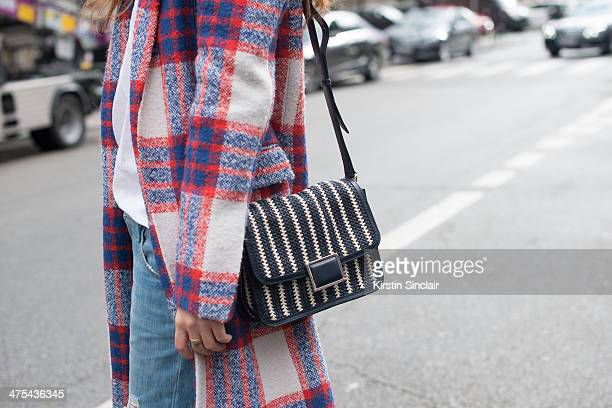 Fashion Blogger Sofya Benzakour wears a Claude Pierlot top Zara coat Marc by Marc Jacobs Jacobs bag and Mango jeans on day 3 of Paris Collections...