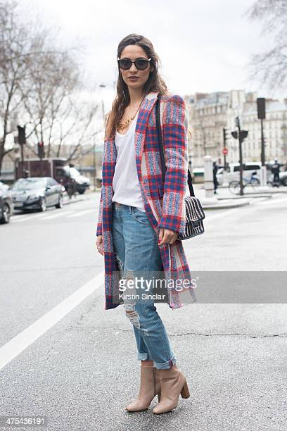 Fashion Blogger Sofya Benzakour wears Chanel sunglasses Claude Pierlot top Zara coat and shoes Marc by Marc Jacobs bag and Mango jeans on day 3 of...