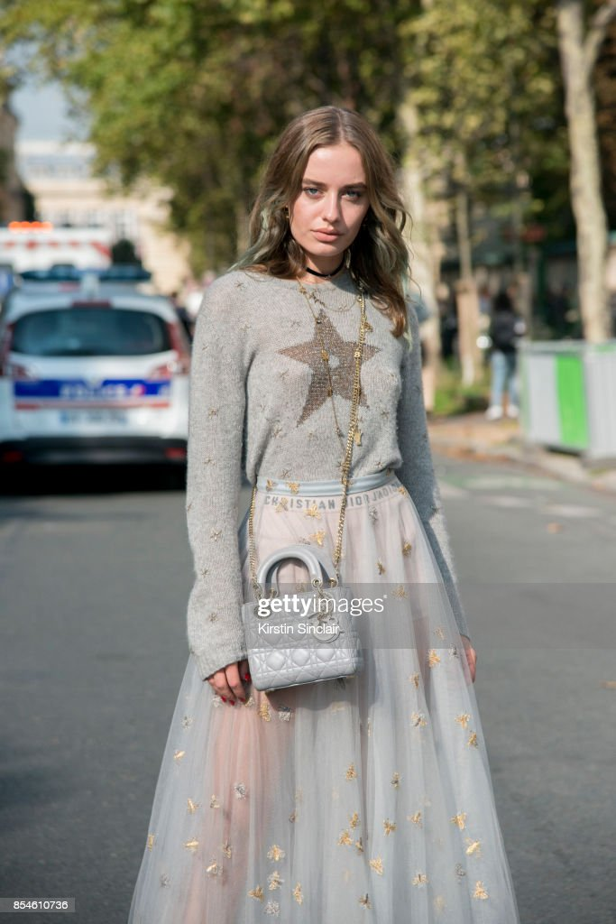 Fashion blogger Sonya Esman wears Dior sweater, skirt and bag day 1 of Paris Womens Fashion Week Spring/Summer 2018, on September 26, 2017 in Paris, France.