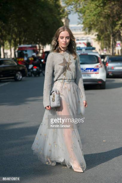 Fashion blogger Sonya Esman wears Dior sweater skirt shoes and bag day 1 of Paris Womens Fashion Week Spring/Summer 2018 on September 26 2017 in...