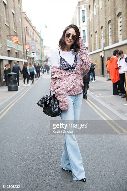 Fashion Blogger Soraya Bakhtiar wears an Anine Bing coat and top Zara jeans and shoes Chanel bag and Ray Ban sunglasses on day 5 of London Womens...