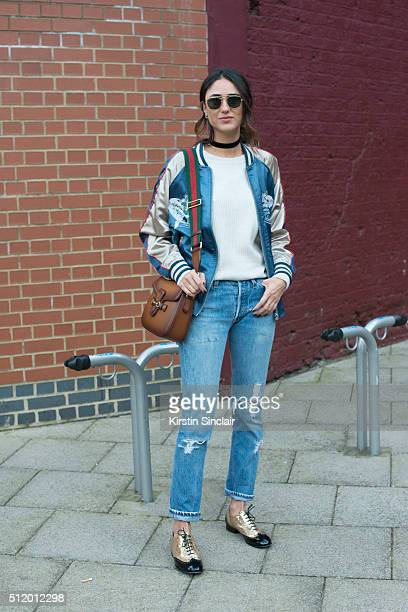 Fashion blogger Soraya Bakhtiar wears an ASOS bomber jacket Leviâs jeans IRO sweater Gucci bag Chanel shoes and Ray Ban sunglasses on day 5 during...