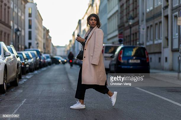 Fashion Blogger Storm Westphal of The Adorable Two wearing Zara coat Cameo the lable dress turtleneck HM Uniqlo pants Prada sunglasses Adidas shoes...