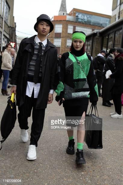 Fashion Blogger stylist Freya Sinyu Siu and AdamChi Lung Chan attend the London Fashion Week Men's Day two Street Style.