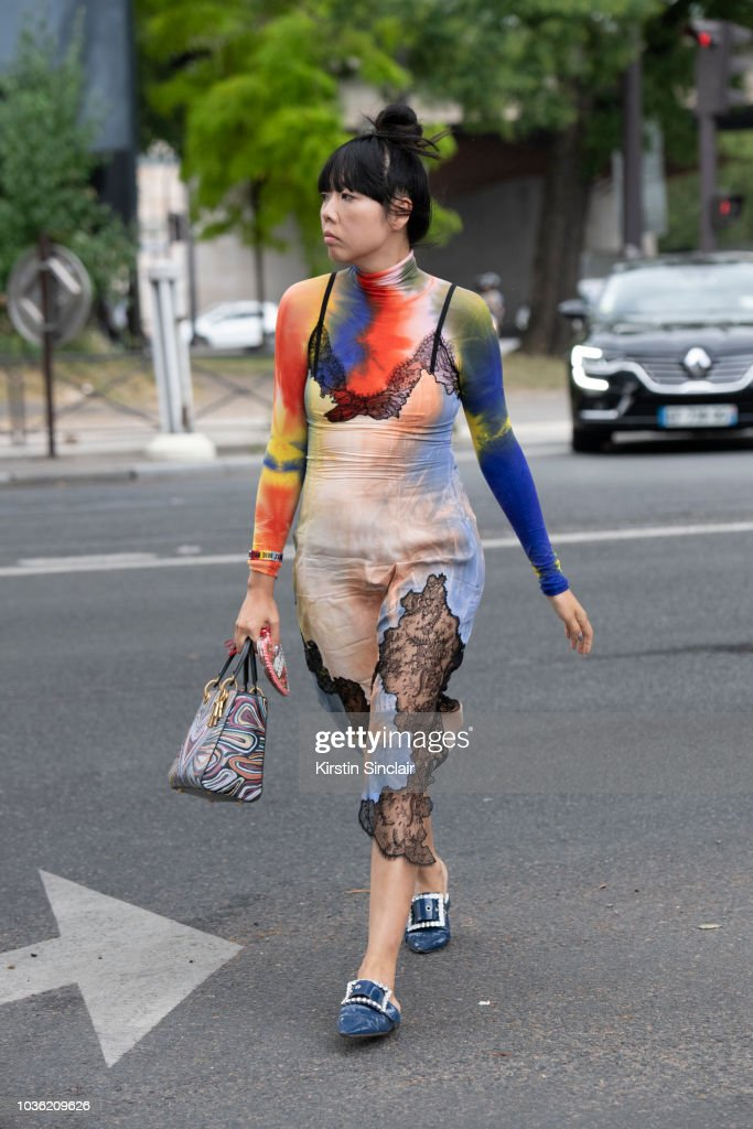 Fashion Blogger Susie Lau wears a Celine Dress, Dior bag and Margiela shoes during Haute Couture Fall Winter 2018/2019 on July 1, 2018 in Paris, France.