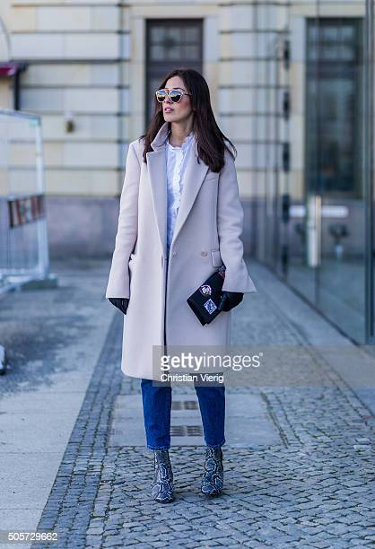 Fashion Blogger Sylvia Haghjoo of Hug You wearing Stella McCartney coat glasses and bag Dior jeans Closed blouse MIH shoes Isabel Marant during the...