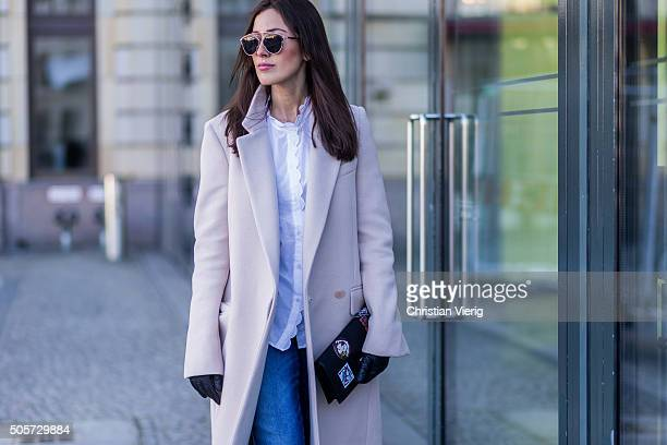 Fashion Blogger Sylvia Haghjoo of Hug You wearing Stella McCartney coat glasses and bag Dior jeans Closed blouse MIH during the MercedesBenz Fashion...