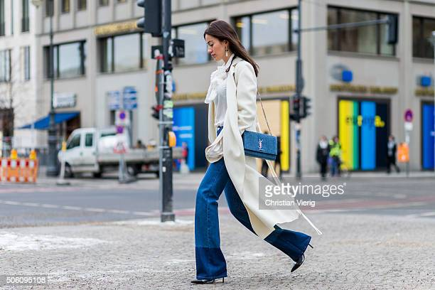 Fashion blogger Sylvia Haghjoo wearing coat Joseph bag Saint Laurent earrings Isabel Marant pants Valentino shoes Gianvito Rossi blouse Gucci during...