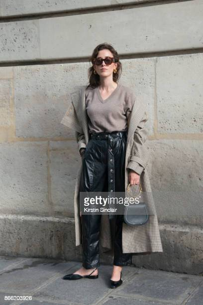 Fashion blogger Sylvia Haghjoo wears a Stella McCartney coat Proenza Schouler trousers Uzwei sweater Chloé bag Céline sunglasses and earrings and...