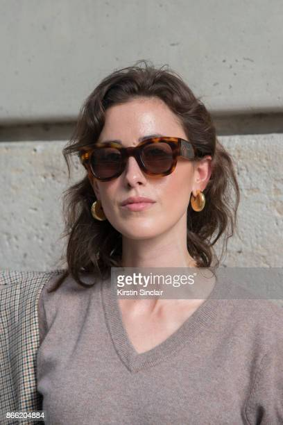 Fashion blogger Sylvia Haghjoo wears a Stella McCartney coat Uzwei sweater Céline sunglasses and earrings day 2 of Paris Womens Fashion Week...