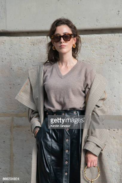Fashion blogger Sylvia Haghjoo wears a Stella McCartney coat Uzwei sweater Proenza Schouler trousers Céline sunglasses and earrings day 2 of Paris...