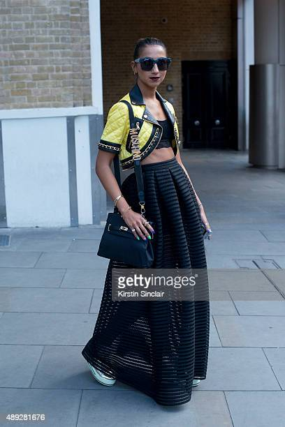 Fashion blogger Talina Naviede wears Maje skirt vintage Moschino bag Moschino jacket Anna Karin Karlsson sunglasses and Urban Outfitters top on day 2...