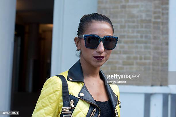 Fashion blogger Talina Naviede wears vintage Moschino bag Moschino jacket Anna Karin Karlsson sunglasses and Urban Outfitters top on day 2 during...