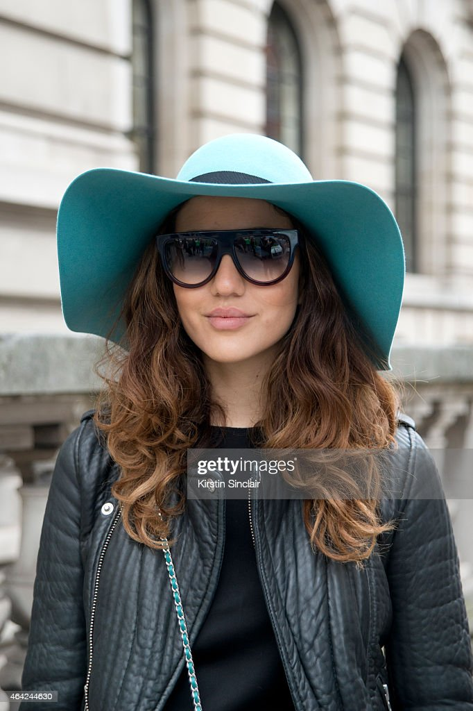 Fashion Blogger Tamara Kalinic wears a Chanel bag, Celine sunglasses, Maison Michel hat and a Maje jacket on day 3 of London Collections: Women on February 22, 2015 in London, England.